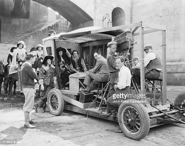 Hollywood director King Vidor filming a coach interior scene for the costume drama 'Bardelys the Magnificent' set in 17th century France Actor John...