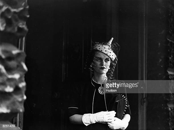 Mrs Charles Sweeney leaves Derby House after attending the display of British fabrics hosted by Lady Maureen Stanley in aid of British Industry