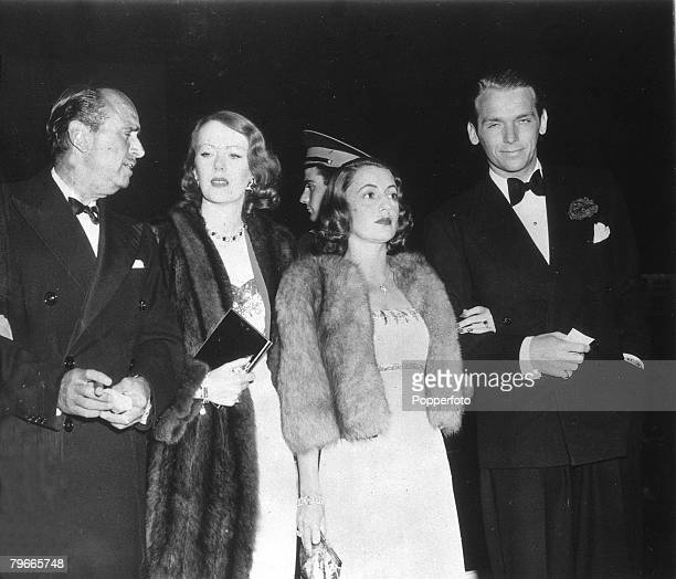 5th May 1939, Hollywood, USA, US actor Douglas Fairbanks Senior with his wife pictured at a film premiere with his son Douglas Fairbanks Junior and...