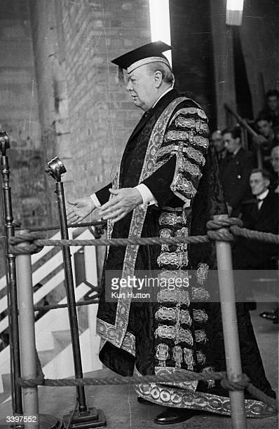British prime minister Winston Churchill in his role as Chancellor of Bristol University praises British Labour politician Ernest Bevin before...