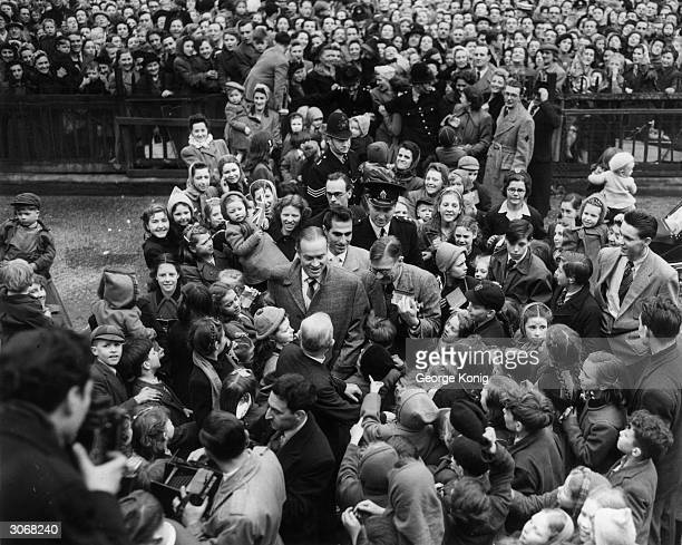American comedian Bob Hope is mobbed by a crowd of fans during a visit to Clubland in Camberwell Road London the benefit club to which he has donated...