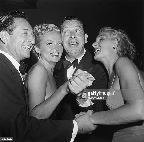 EXCLUSIVE American comedian Milton Berle dances with actor Myrna Dell as actor Norma Shearer and her husband Marty Arouge flank them at Betty...
