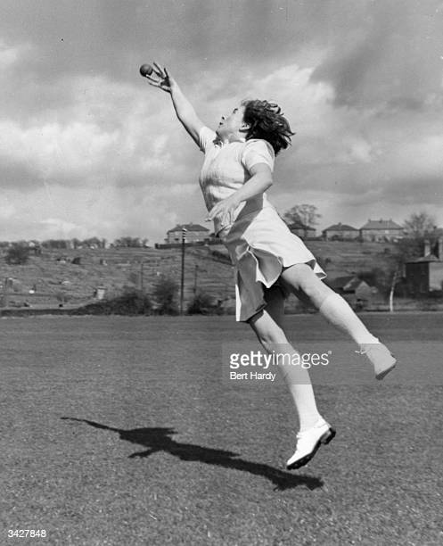 Hazel Sanders one of the women cricketers chosen for the first Test against the Australians leaps to try and catch a ball during a workout Original...