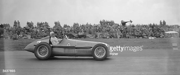 Italian racing driver Giuseppe Farina in his AlfaRomeo at Silverstone