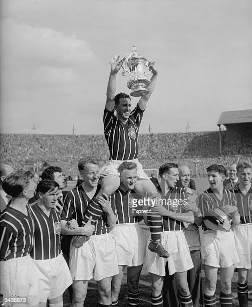 Manchester City captain Roy Paul is chaired by goalkeeper Bert Trautmann after Manchester City's 31 victory against Birmingham City in the FA Cup...