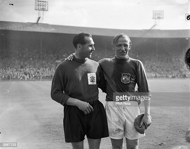 Merrick the goalkeeper for Birmingham City and Trautmann goalkeeper for Manchester City embrace at the end of the FA Cup Final Match at Wembley...