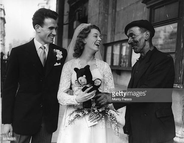 Mr Nye a chimney sweep congratulating newlywed couple Maureen Edwards and Alfred Saunders after their wedding in London