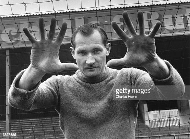 The safe hands of Birmingham City FC and England goalkeeper Gil Merrick Original Publication Picture Post 8379 The Cup Is In Their Hands pub 1956