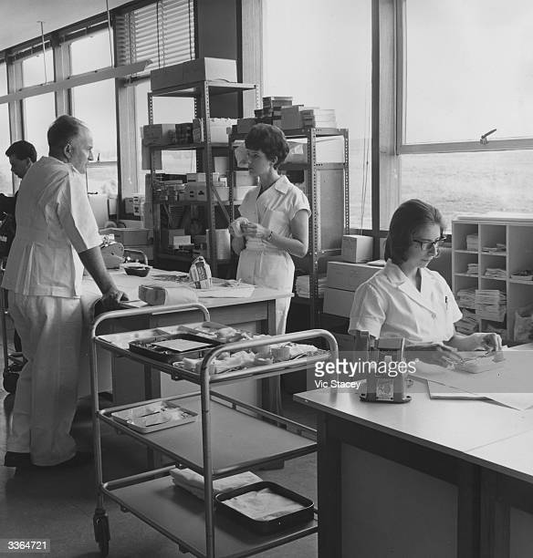 Laboratory workers at the central sterile supply department at the newly opened Princess Margaret Hospital at Swindon England