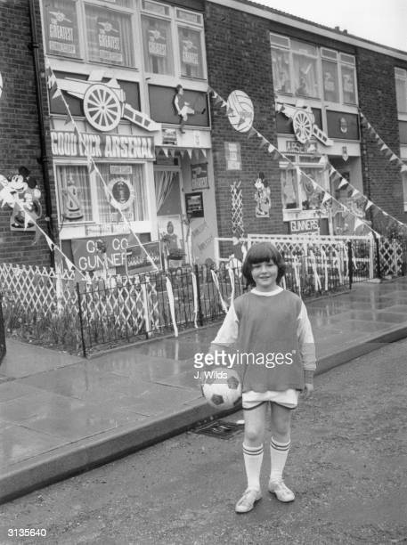 10 year old Gary Chapman outside Fife Terrace in Islington a London housing estate festooned with bunting and support slogans for Arsenal Football...
