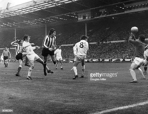 Leeds United players Norman Hunter David Harvey and Allan Clarke watch as the Sunderland footballer Ian Porterfield scores the winning goal during...