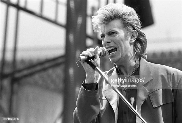 5th MAY: David Bowie performs live on stage at the Feijenoord Stadium in Rotterdam, Netherlands during the Glass Spider tour on 30th May 1987.