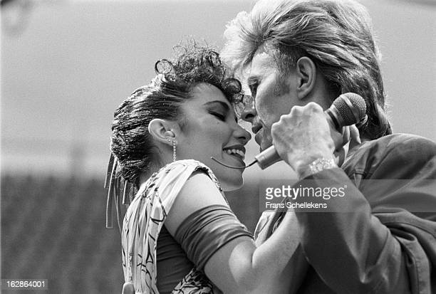 5th MAY: David Bowie performs live on stage with dancer Melissa Hurley at the Feijenoord Stadium in Rotterdam, Netherlands during the Glass Spider...