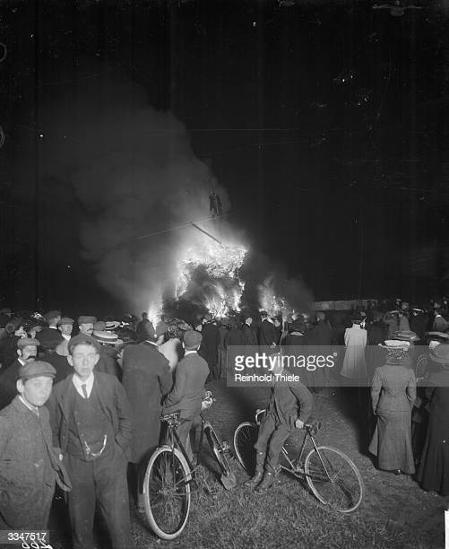 Crowds gather to celebrate Guy Fawkes night and watch the burning of an effigy of Guy Fawkes on a bonfire