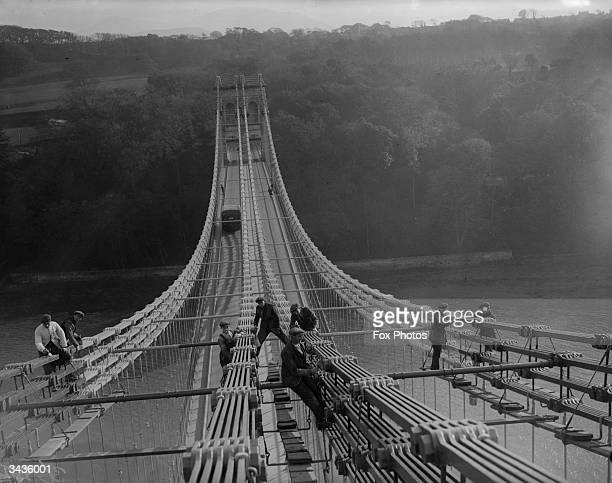 Painting the bridge over the Menai straits Anglesey north Wales