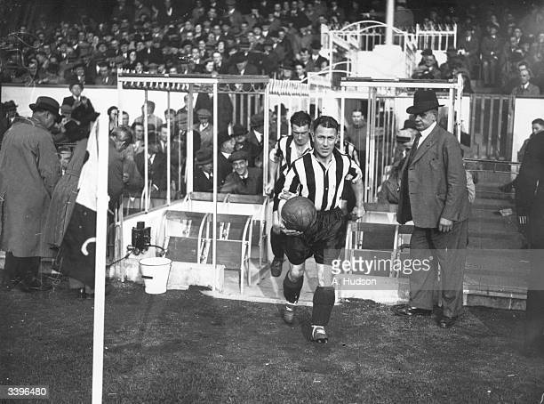 Grimsby Town FC football player Bestace leading his team out