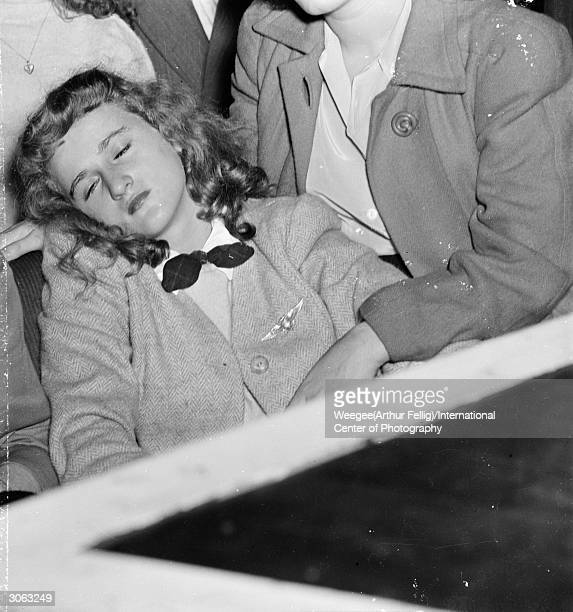 A young woman faints during a Frank Sinatra concert at the Paramount Theatre from the excitement of seeing her idol Photo by Weegee/International...