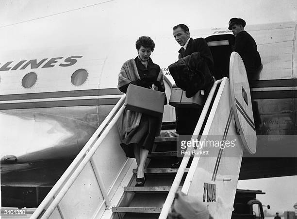 American singer Frank Sinatra and actress Ava Gardner arriving at london Airport