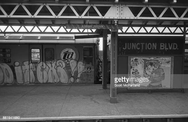 A graffiti covered subway train sits at the Junction Boulevard station in Corona Queens