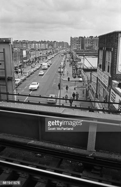 Elevated view from the Seven Train Subway platform of small businesses lining Roosevelt Avenue in the heart of Corona Queens
