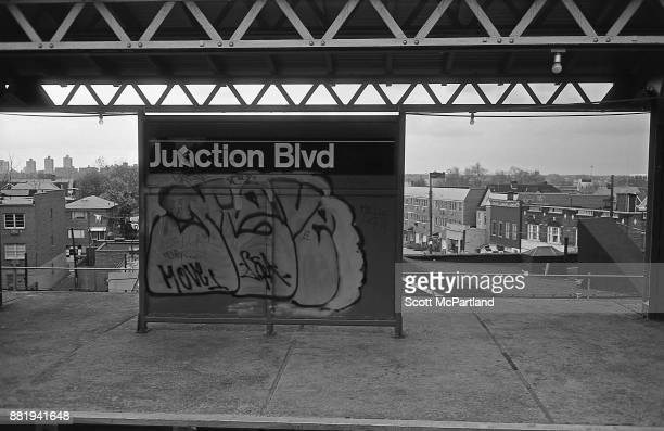 Graffiti covers the Junction Boulevard subway sign on the elevated line in Corona Queens