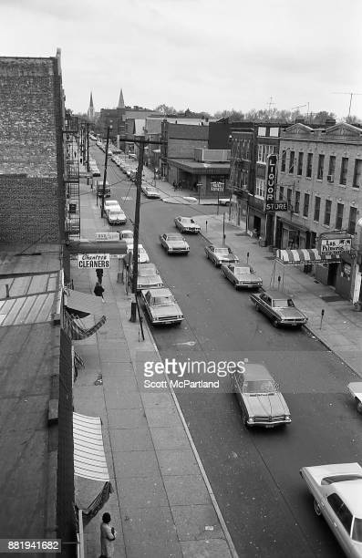 High angle view from the elevated subway line of a street lined with small businesses in Corona Queens
