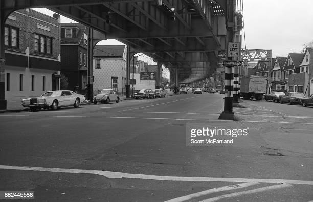 Street level view under the elevated subway line along Roosevelt Avenue in the heart of Corona Queens