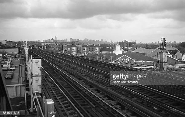 View of the New York City Skyline and surrounding cityscape from the elevated subway platform at 103rd Street in Corona Queens