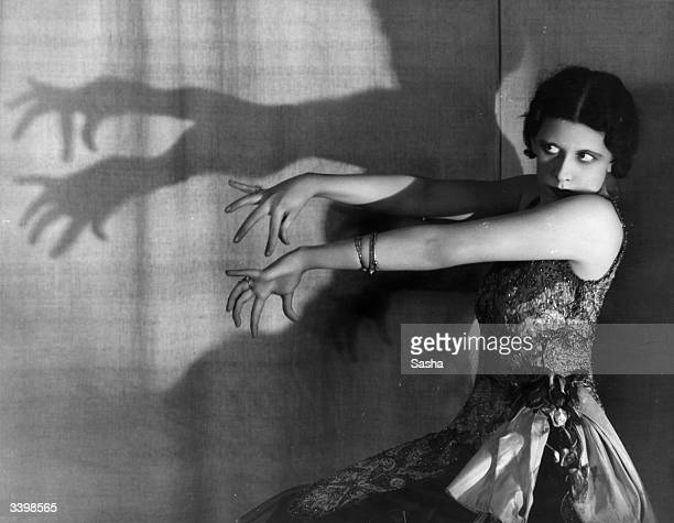 Dancer Laura Devine performing a shadow dance during a production of C B Cochran's show 'This Year of Grace' at the London Pavilion