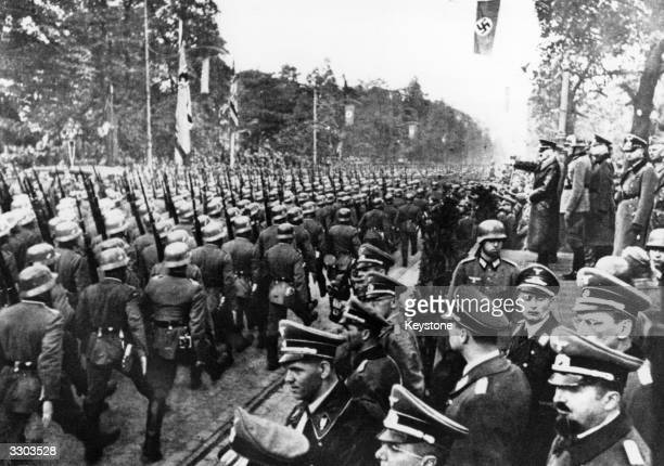 German troops parade in front of Adolf Hitler and Nazi Generals after entry into Warsaw