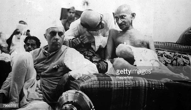 5th October 1942 Bombay India Indian political and spiritual leader and social reformer Mahatma Gandhi listens while Mahadev Desai his secretary...