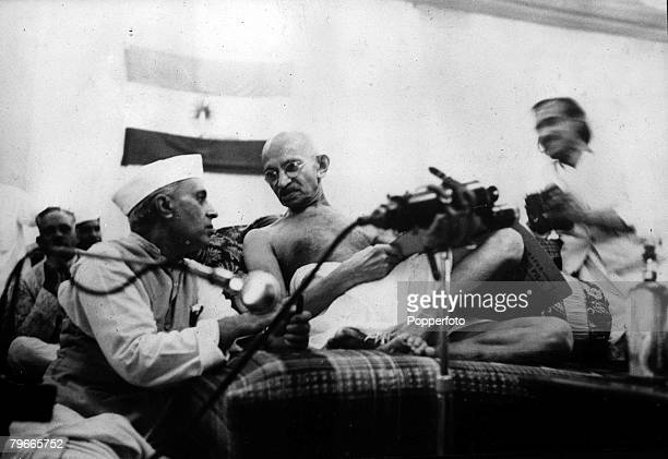 5th October 1942 Bombay India Indian political and spiritual leader and social reformer Mahatma Gandhi discusses a point with Pandit Jawaharlal Nehru...