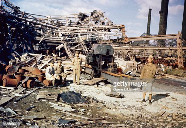 Japanese soldiers in Nagasaki amid the devastation caused by the dropping of the atomic bomb on August 9 1945 The plutonium implosiontype bomb was...