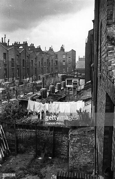 A mass of clothes hanging on the washing line at a garden in Hoxton Original Publication Picture Post 4224 All In A Hoxton Garden pub 1946