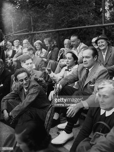 Britishborn American comedian Bob Hope and his wife Dolores watching the Ryder Cup golf tournament at Wentworth equipped with a handy shooting stick...