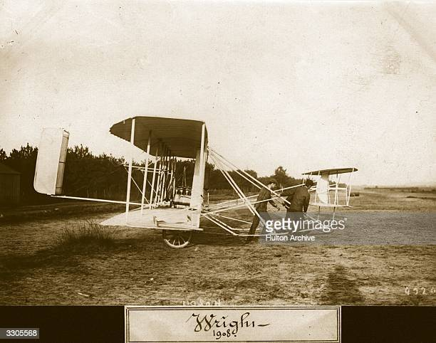 The Wright Flyer II biplane on wheels being pulled out onto a field Aeroplane Album Vol 2 Page 52