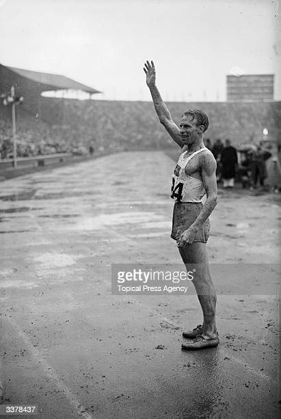 Swedish athlete Henry Eriksson waving to a crowd afer winning the 1500 metres event in the 16th Olympiad at Wembley Stadium London