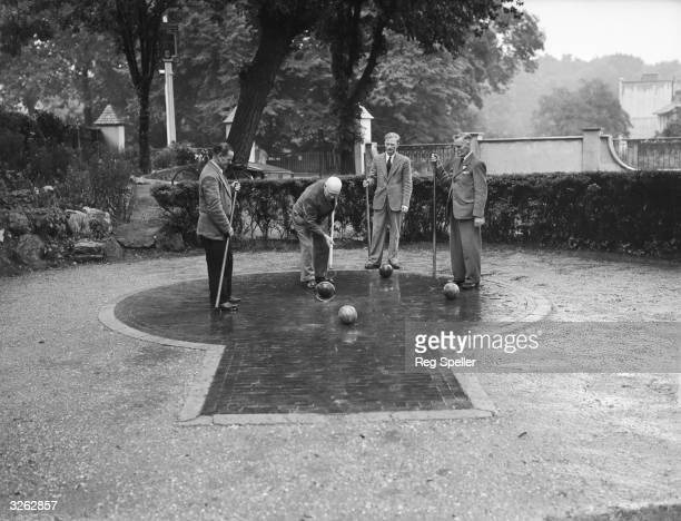 The ancient game of paille maille being played on the court at the Freemason's Arms Downshire Hill Hampstead the game's only venue in Britain The...