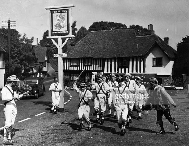 A group of Morris dancers dancing in the village square in Tonbridge Kent