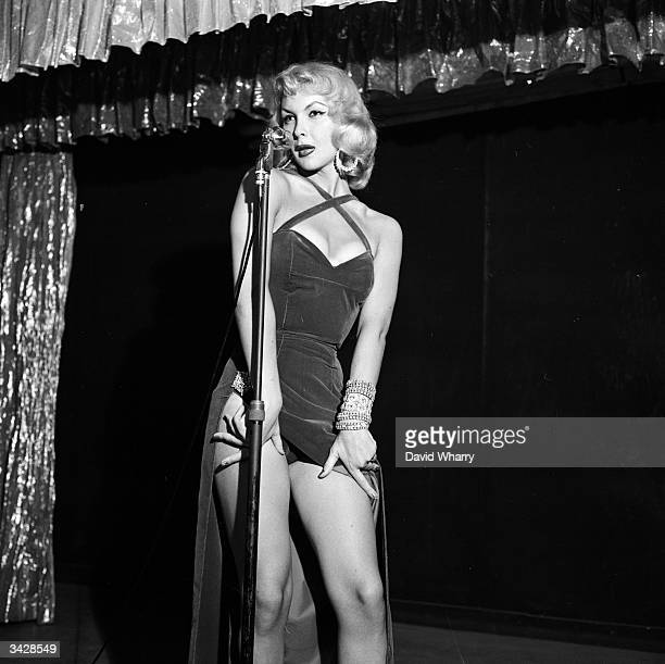 French transvestite Jean Pierre Rene performs at the 'JuanlesPins' club in Paris singing husky songs as 'La Belle Bambi'