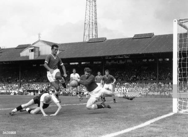 Chelsea goalkeeper Reg Matthews saves at close range from Burnley's Ray Pointer
