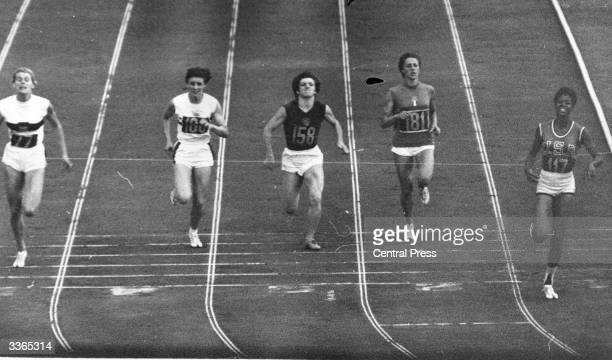 American athlete Wilma Rudolph winning an Olympic Gold medal in the 200 metres final which she ran in 24 seconds at the stadium in Rome