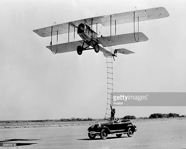 A stunt man climbs a ladder from a moving car to an aeroplane from the film 'The Great Waldo Pepper' directed by George Roy Hill and produced by...