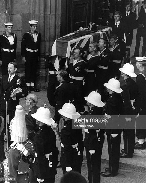The coffin of the Admiral of the Fleet Lord Louis Mountbatten is carried by eight pall bearers from the Royal Navy In the background the Earl's...