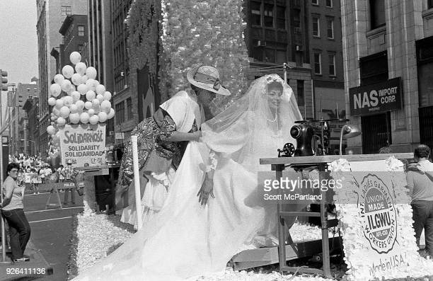 New York A laborer with the International Ladies Garment Workers Union wears a wedding dress and sits in front of a sewing machine on a float during...