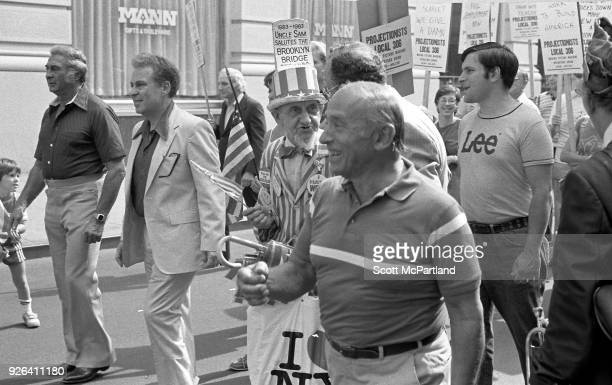 New York An elderly man dressed as Uncle Sam stands with other laborers and waves an American Flag at a labor union protest in downtown Manhattan The...