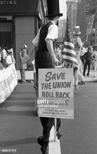 New York Protesters on stilts stand on Broadway during an International Ladies Garment Workers Union rally They are protesting the increased clothing...