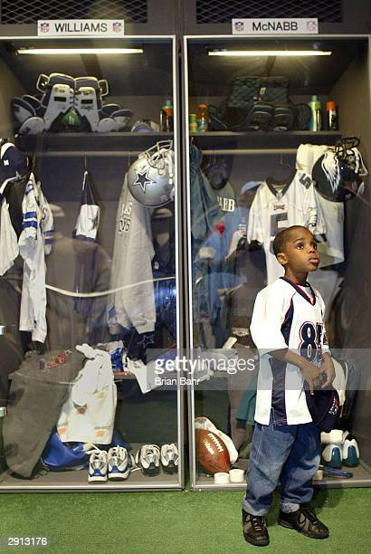 5year old Darus Cofield of Houston looks at a locker room scene which iincludes lockers for Roy Williams of the Dallas Cowboys and Donovan McNabb of...