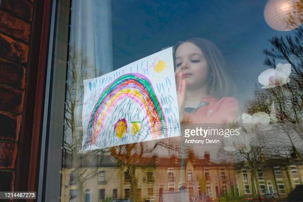 5yearold Charlie Rose places a drawing of a rainbow in her front window as schools remain closed on March 24 2020 in Manchester United Kingdom...