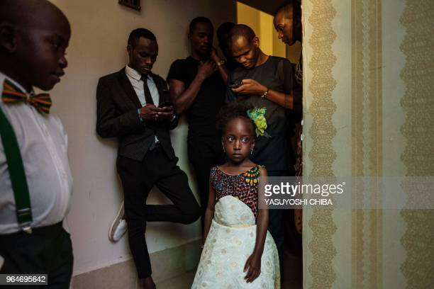 TOPSHOT 5yearold Prisca Akinyi and 7yearold Barley Roberts wait with other models before presenting ecofashion using recycled or biodegradable...